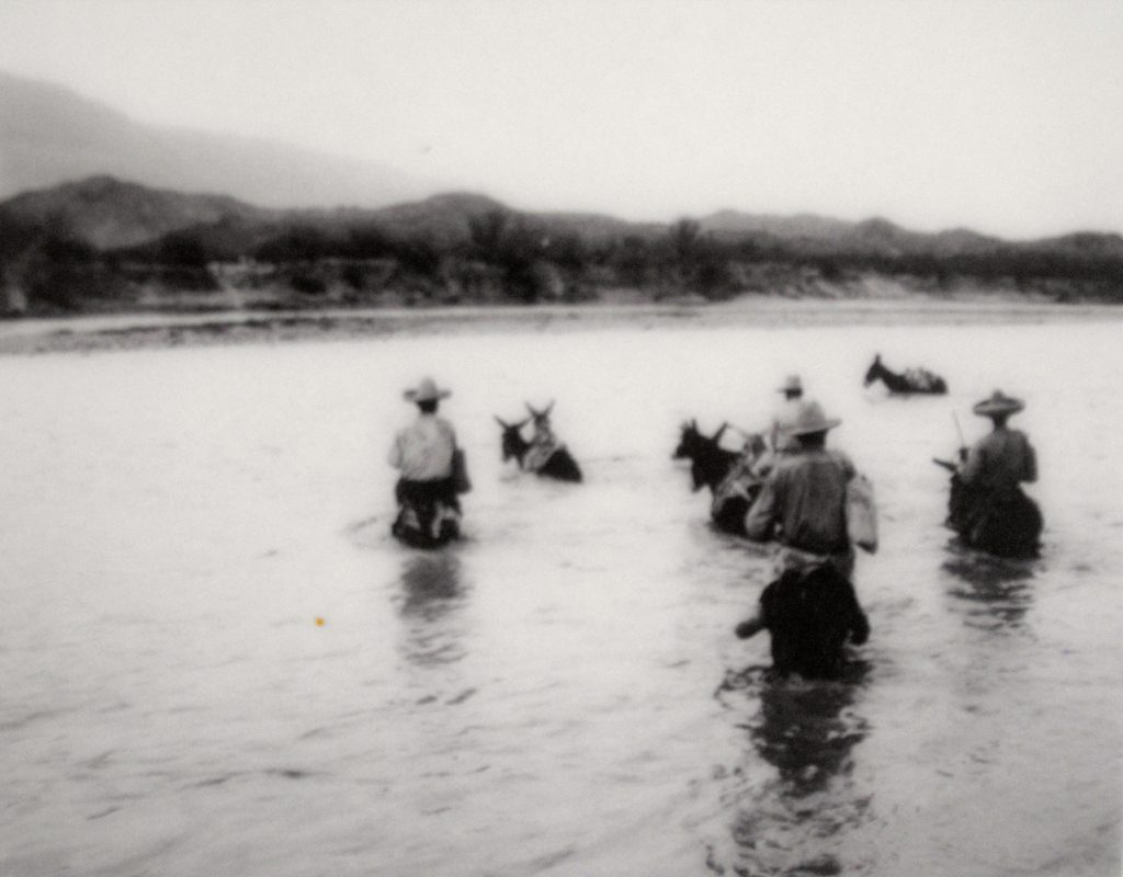 Texas Rangers fording the Rio Grande